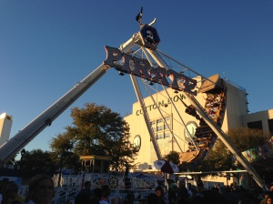 Swinging pirate ship in front of the Cotton Bowl football stadium